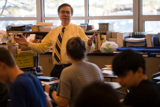 Spanish teacher Tony Espinoza jokingly apologizes for not giving a quiz to his class on Tuesday, April 23, 2019, at Poudre High School in Fort Collins, Colo.