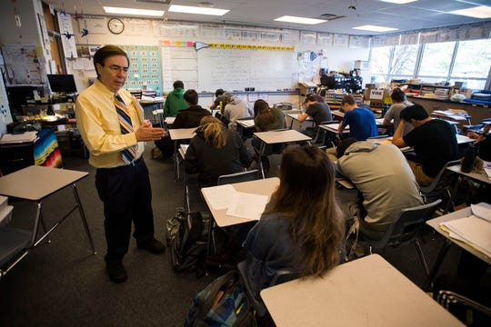 Spanish teacher Tony Espinoza works with junior Elizabeth Reyman during a class on Tuesday, April 23, 2019, at Poudre High School in Fort Collins, Colo.