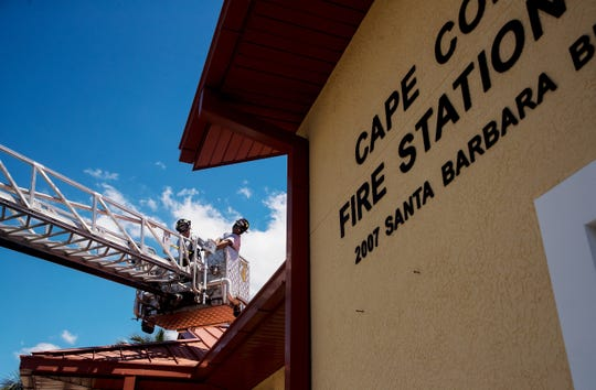 Cape Coral Fire Department engineer, David Crockett, left, and firefighter, Jason Rosas perform a daily check on the ladder truck at Station 4 off of Santa Barbara Boulevard in Cape Coral on Tuesday April, 23. 2019.
