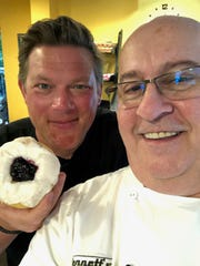 "Celebrity Chef Tyler Florence, host of Food Network's ""The Great Food Truck Race,"" posed with Bennett's Fresh Roast owner Bob Grissinger in his Fort Myers shop on Tuesday April 23, 2019."