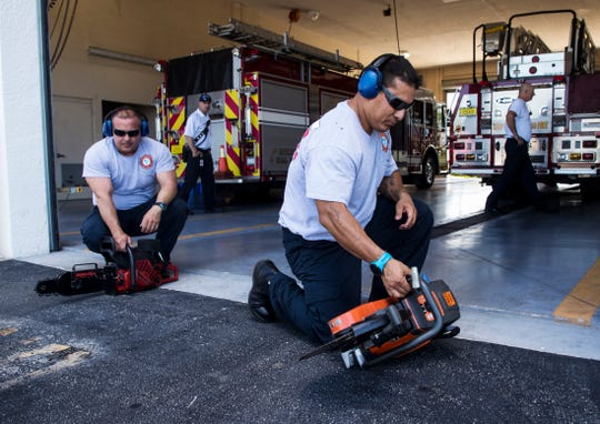 Cape Coral Fire Department engineer,Noel Rodriguz. left, and firefighter, Jason Rosas perform a check on equipment at Station 4 off of Santa Barbara Boulevard in Cape Coral on Tuesday April, 23. 2019.
