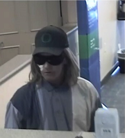 Police released an image of a man wearing a woman's wig and gauze on his eye who is believed to have attempted to rob the Fifth Third Bank Tuesday.