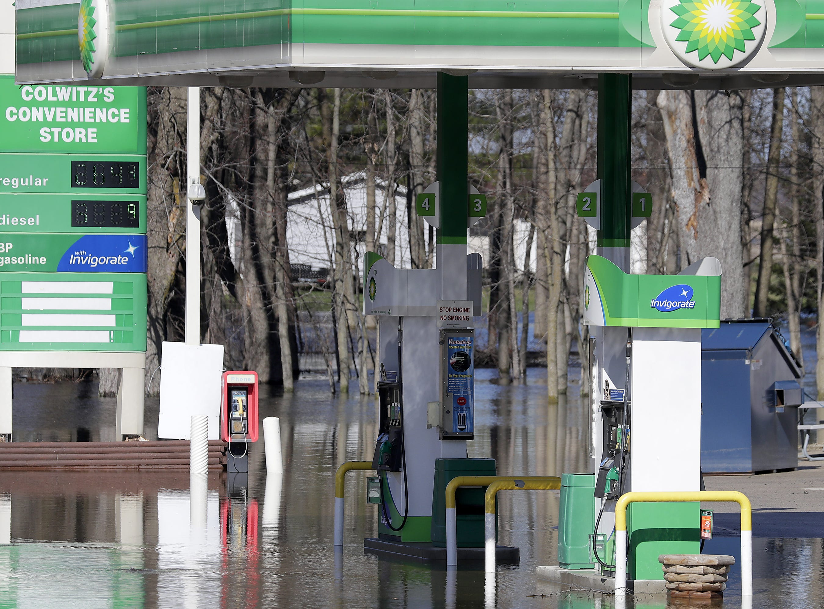 Flooded gas pumps at the Riverside Pump and Munch, formerly Colwitz's Convenience Store, as during flooding along the Wolf River on Tuesday, April 23, 2019, in Shiocton, Wis.  Wm. Glasheen/USA TODAY NETWORK-Wisconsin.
