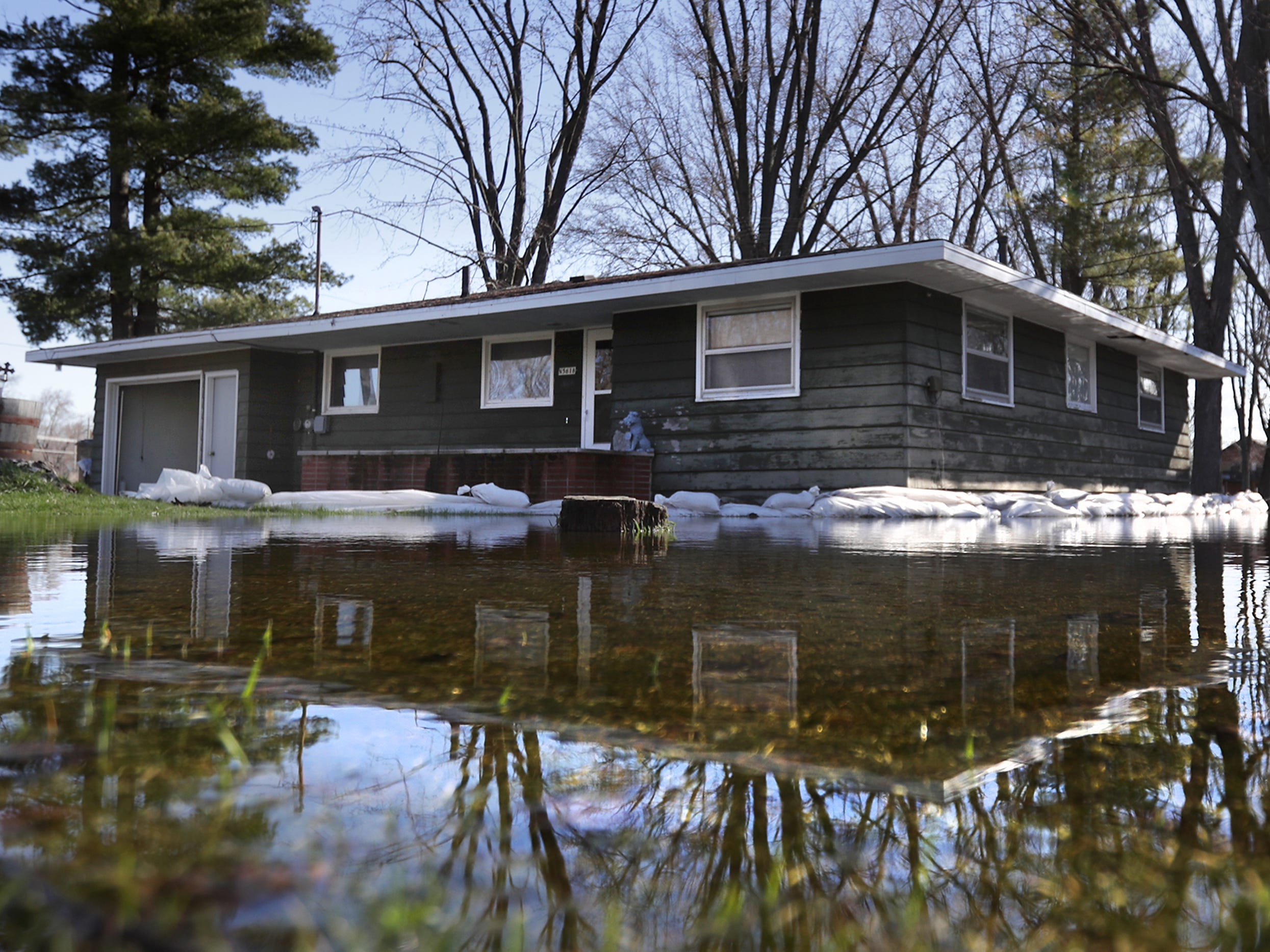 A home is surrounded by sandbags and flood water along Mill St. during flooding along the Wolf River on Tuesday, April 23, 2019, in Shiocton, Wis.  Wm. Glasheen/USA TODAY NETWORK-Wisconsin.