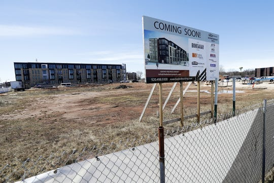 Construction continues on apartment buildings at Holmgren Way and Morris Avenue in Ashwaubeno