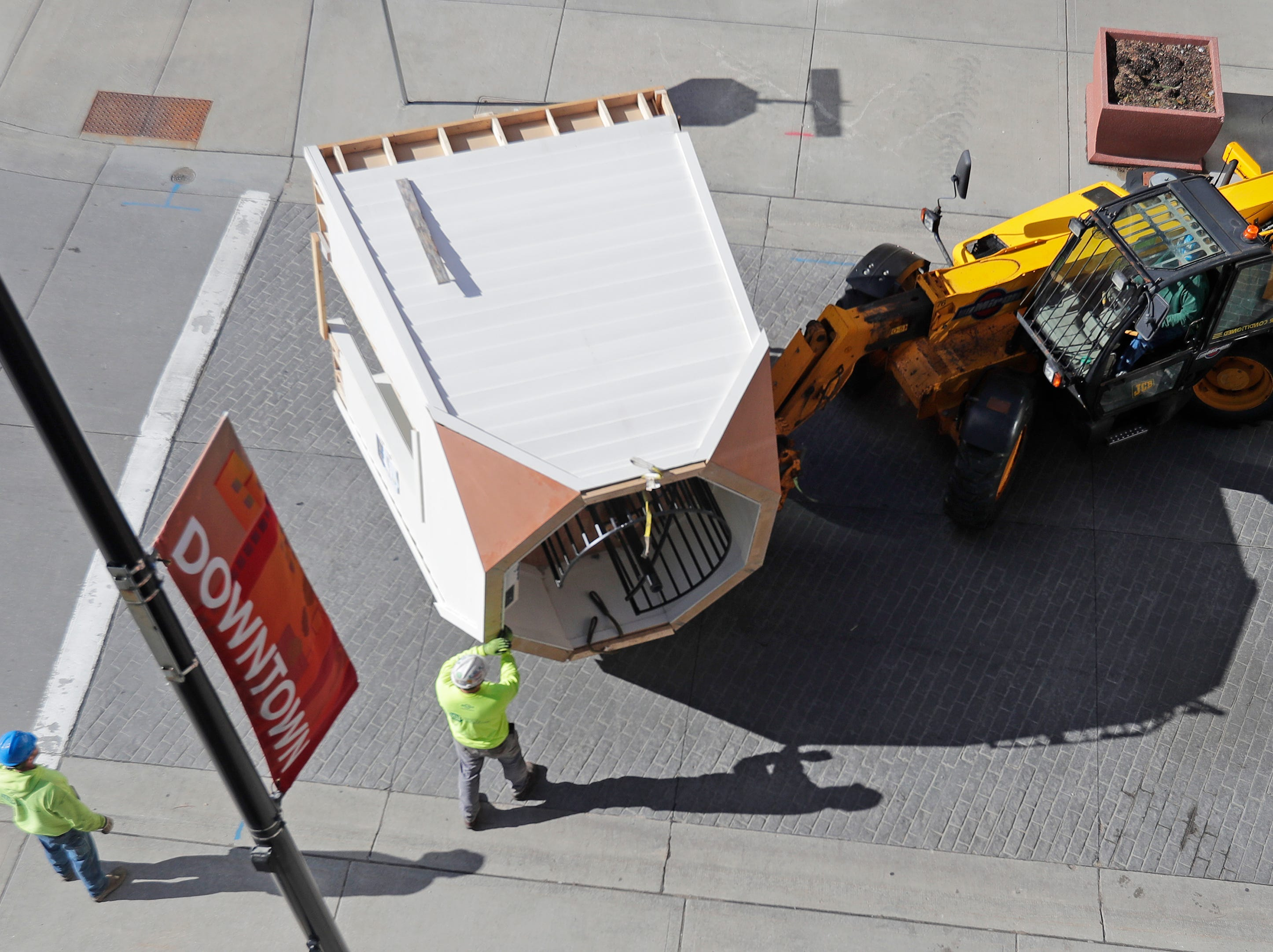 Workers move the lighthouse exhibit out of the Children's Museum of Green Bay on Tuesday, April 23, 2019 in Green Bay, Wis. The museum is moving from its downtown location and will reopen in its new facility near Bay Beach Amusement Park in early May.