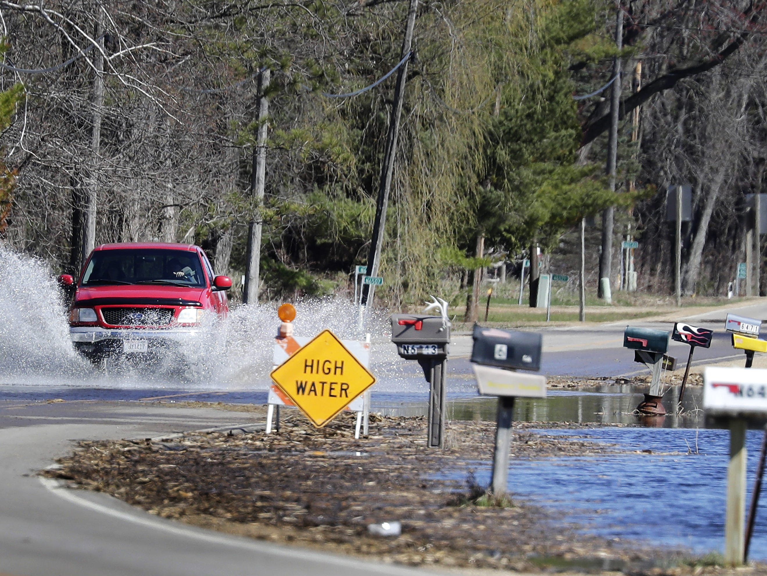 High water covers Hwy 187 during flooding along the Wolf River on Tuesday, April 23, 2019, in Shiocton, Wis.  Wm. Glasheen/USA TODAY NETWORK-Wisconsin.