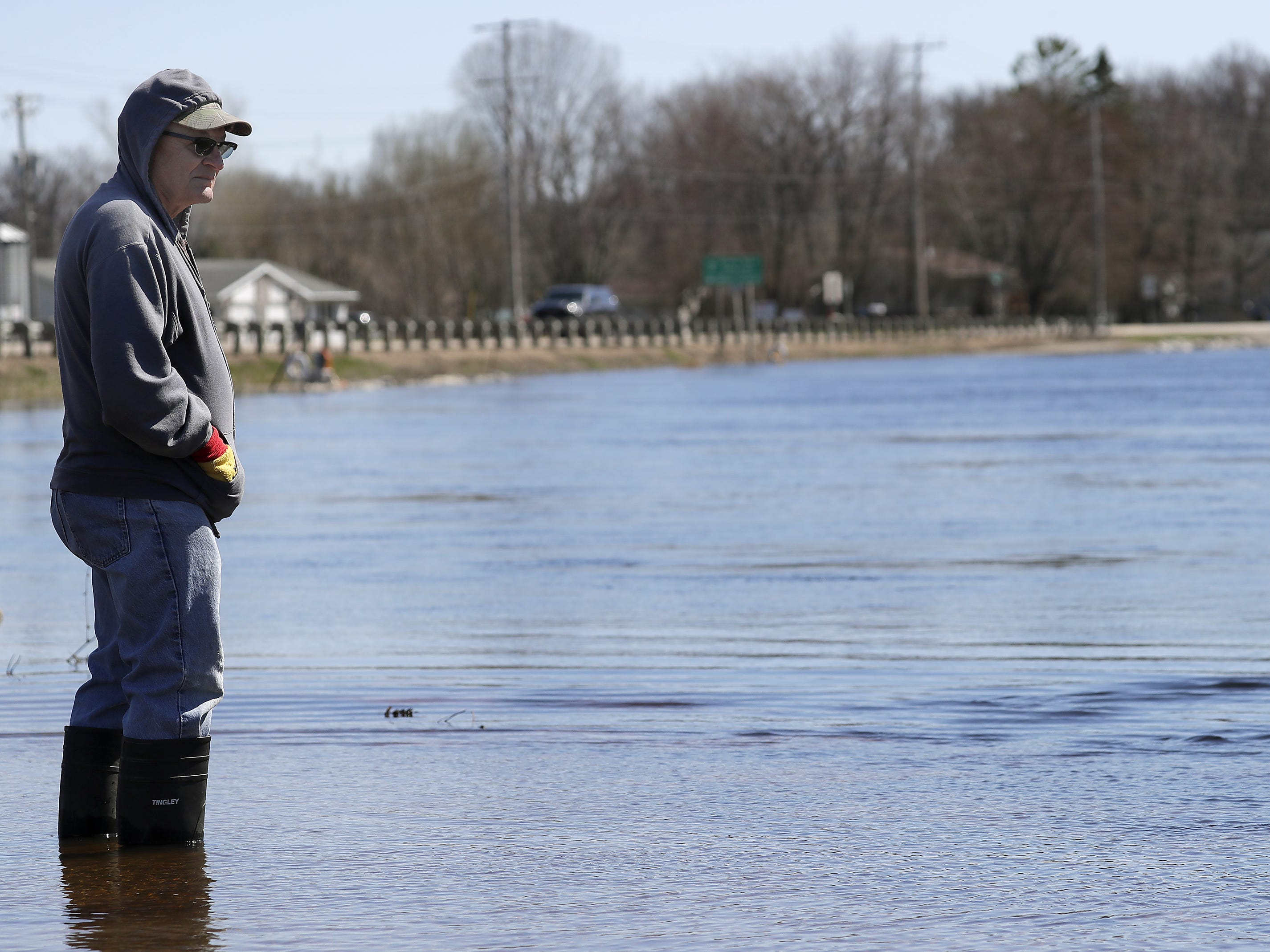 Dan Guyette, Mackville, watches the spring sturgeon spawn from a flooded trail at Bamboo Bebd during flooding along the Wolf River on Tuesday, April 23, 2019, in Shiocton, Wis.  Wm. Glasheen/USA TODAY NETWORK-Wisconsin.
