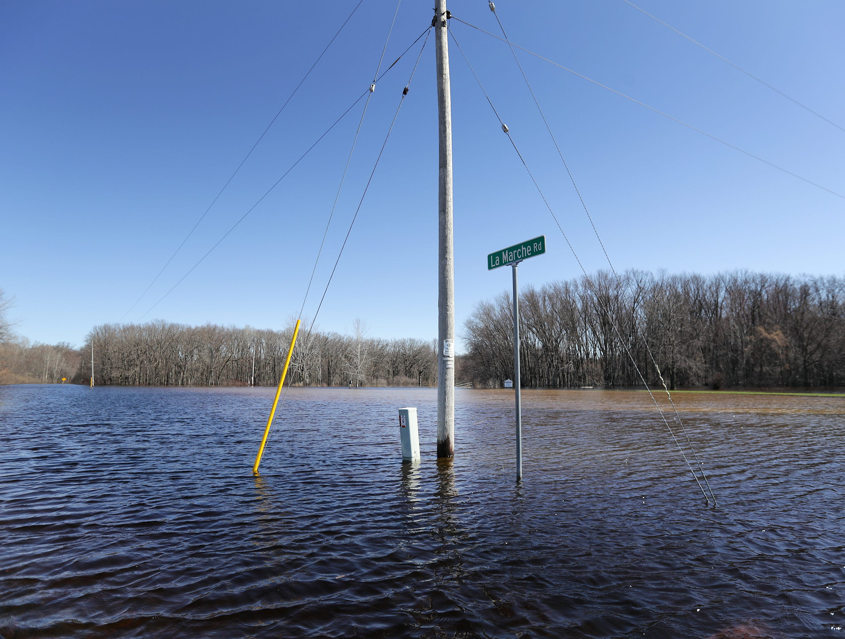 Outagamie County Parks' Koepke Access boat landing and parking lot are covered in water during flooding along the Wolf River on Tuesday, April 23, 2019, in Shiocton, Wis.  Wm. Glasheen/USA TODAY NETWORK-Wisconsin.