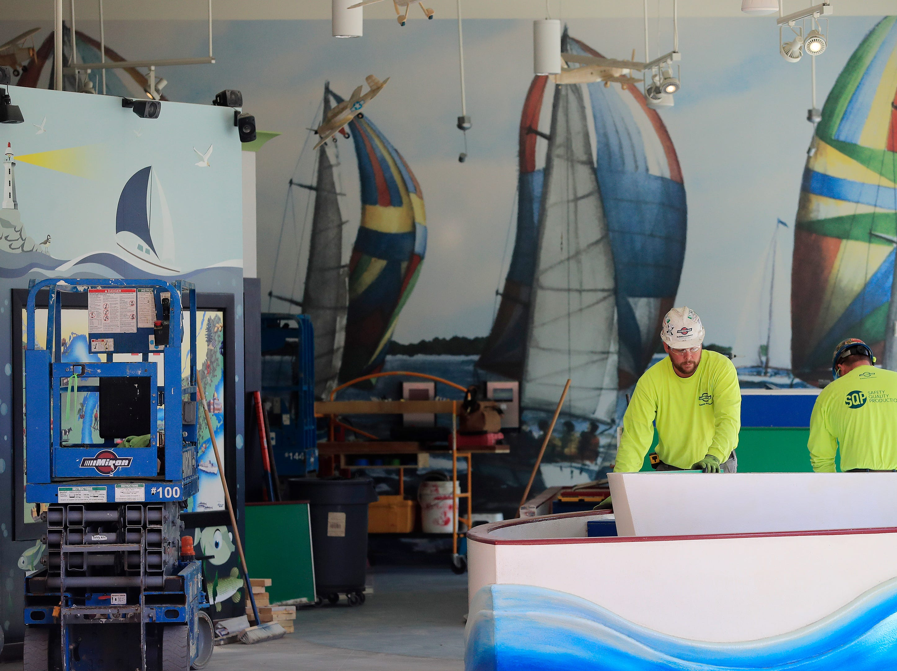Workers move a boat exhibit out of the Children's Museum of Green Bay on Tuesday, April 23, 2019 in Green Bay, Wis. The museum is moving from its downtown location and will reopen in its new facility near Bay Beach Amusement Park in early May.