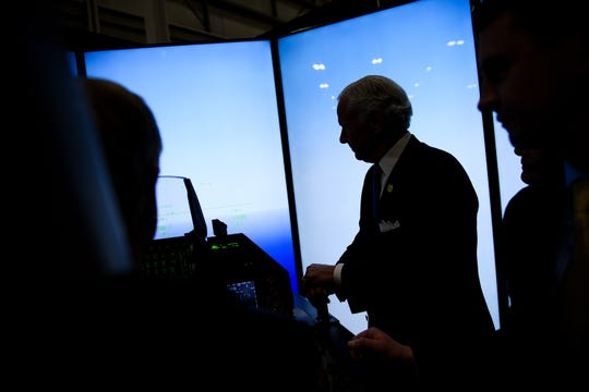 Gov. Henry McMaster watches as Sen. Lindsey Graham tries out an F-16 simulator during a ribbon cutting ceremony for the fighter jet's production line at Lockheed Martin Tuesday, April 23, 2019.