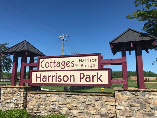The sign for the Cottages at Harrison Bridge subdivision in Simpsonville, where several pet cats were allegedly stolen by an animal trapper hired by other residents.