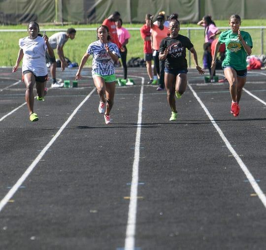Hillcrest High School relay members practice sprints at the school track Monday. From left; Zariere Dumas, Tariney Pepper, Taja Booker, and Zahira Jones.