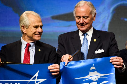 Peter Navarro, left, and Gov. Henry McMaster during a ribbon cutting ceremony for the F-16 fighter jet production line at Lockheed Martin Tuesday, April 23, 2019.