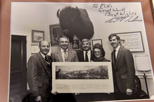 Mike Labriola appears second from the left in this photo.  Labriola was instrumental in getting the Lewis and Clark Interpretive Center built in the 1990's, looks through slides from the early days of the Lewis and Clark Honor Guard.