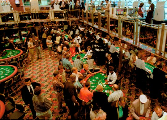 In this June 3, 1996, file photo, gamblers fill the tables on two decks during a practice cruise on the Majestic Star Casino in Gary, Ind. Montana Gov. Steve Bullock signed a bill Friday which allows the Montana State Lottery to oversee wagering on sports in the state.