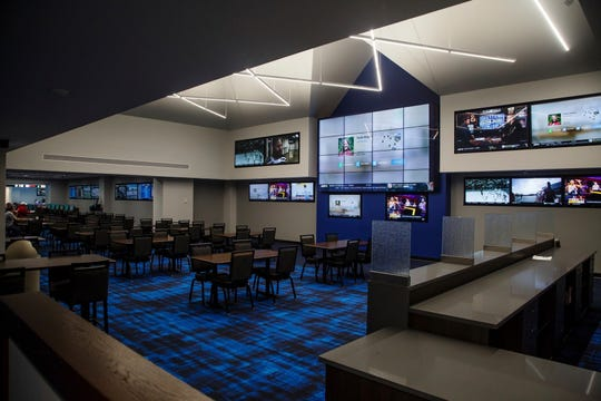 The new sports book at Prairie Meadows sits ready and waiting for sports gambling, on Wednesday, Feb. 20, 2019, in Altoona, Iowa. The Iowa House passed a bill Monday, April 22, 2019,  that legalizes for the first time in Iowa betting on sporting events and fantasy sports, sending it to the governor for consideration. (Brian Powers/The Des Moines Register via AP)