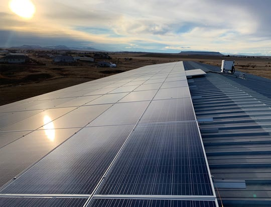 Solar panels on the roof of a warehouse of Timeless Seeds are powering operations at Timeless Seeds in Ulm.