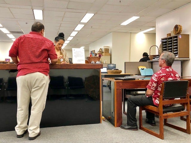 Sen. Jim Moylan, right, was among the last ones to beat the 5 p.m. April 22 deadline to file public official financial disclosure forms at the Guam Election Commission. 154 of 359 GovGuam officials failed to meet Monday's filing deadline.