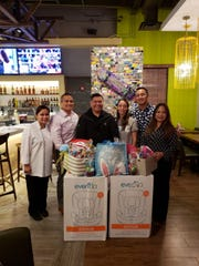 The Rotary Club of Northern Guam along with California Pizza Kitchen hosted a fundraiser for Harvest House. Pictured from left, CPK General Manager Debbie Eding, Rotarian Charlie Hermosa, past Assistant District Gov. Wayne S.N. Santos, Harvest House Executive Director Bethany Taylor, Rotarian John E. Ilao and Chairwoman Rotarian Jean Chabanne.