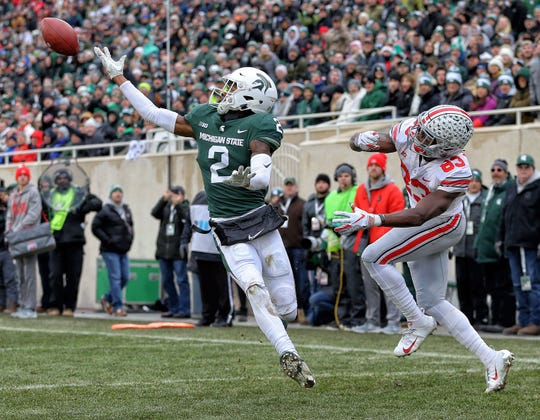 Michigan State cornerback Justin Layne (2) breaks up a pass intended for Ohio State wide receiver Terry McLaurin.