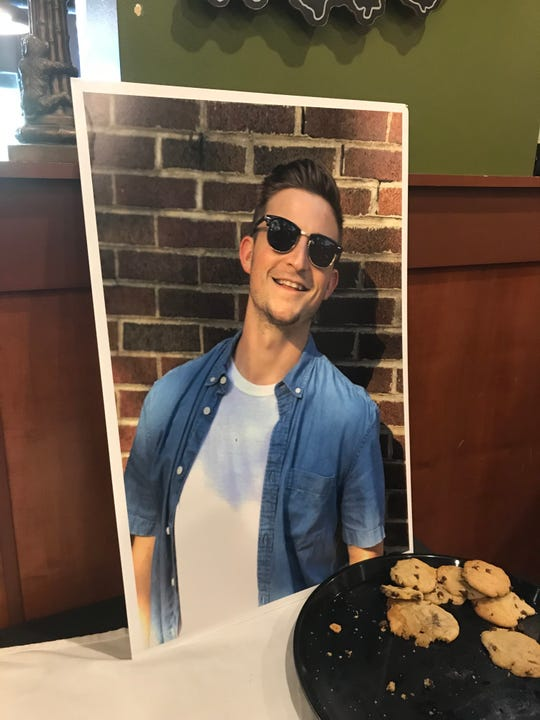 A photo of David R. Short II was on display at Jockamo Upper Crust Pizza location in Irvington, where a memorial event was held in his honor on Monday, July 22, 2019. Short, an Indianapolis Fire Department recruit died Friday night in a head-on crash in Hancock County.