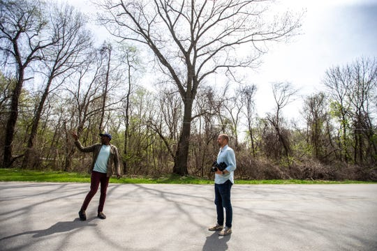 """University of Iowa and West High graduate Mokotsi Rukundo, left, scouts filming locations with Brian Lucke Anderson on their first feature length screenplay together titled, """"East of Middle West,"""" Tuesday, April 23, 2019, in Johnson County, Iowa."""