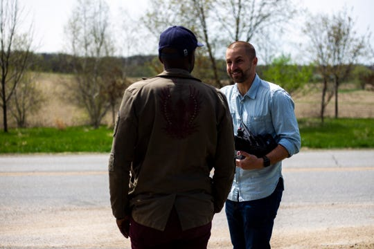 """University of Iowa and West High graduate Mokotsi Rukundo scouts filming locations with Brian Lucke Anderson, right, on their first feature length screenplay together titled, """"East of Middle West,"""" Tuesday, April 23, 2019, in Johnson County, Iowa."""