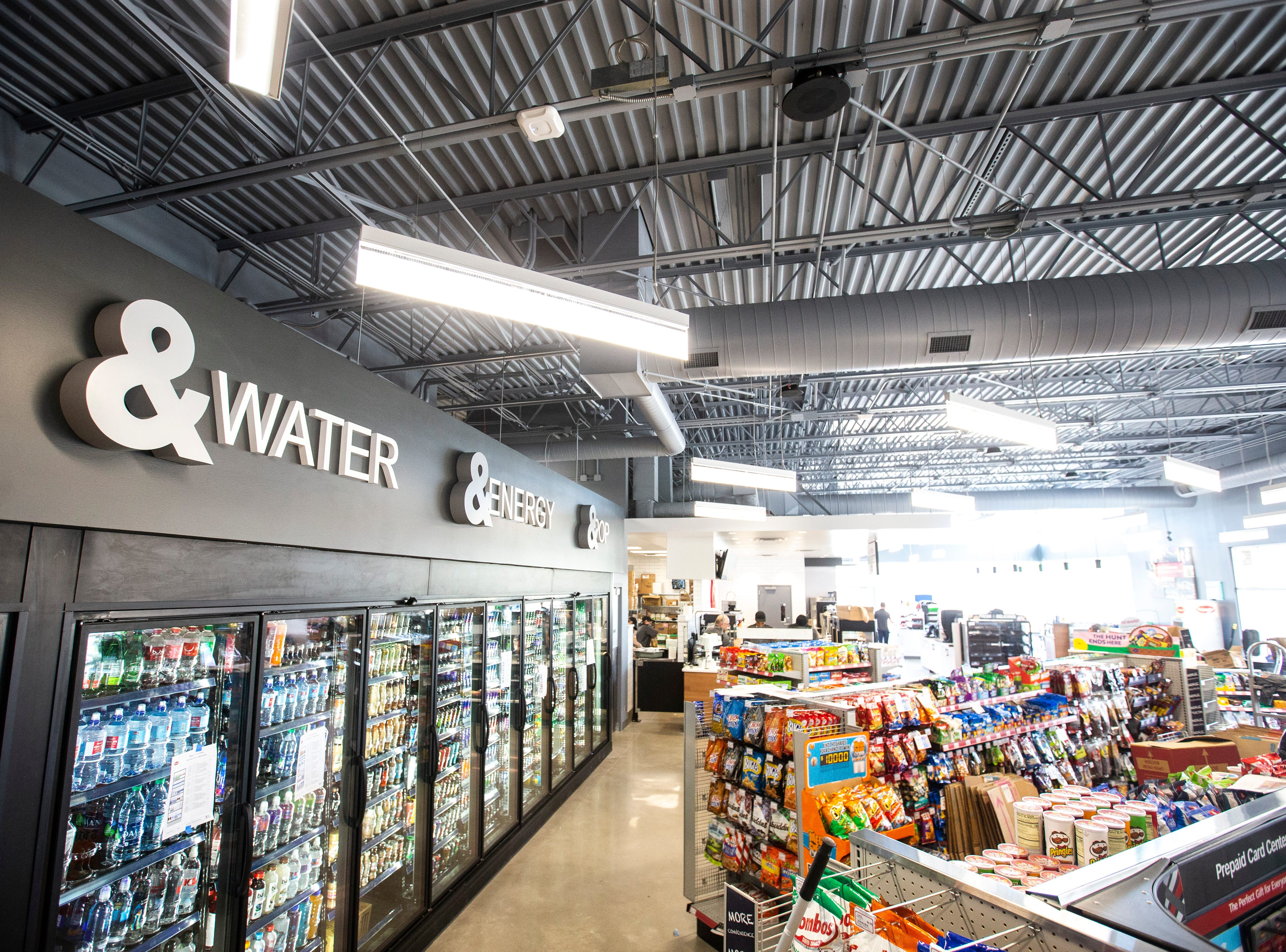 Construction nears competition as items get stocked inside, Tuesday, April 23, 2019, at a new Kum & Go location on the corner of Muscatine and First Avenues on the east side of Iowa City, Iowa.