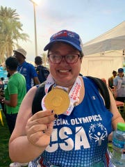 Cassie Taber with her gold medal at the Special Olympics World Games.