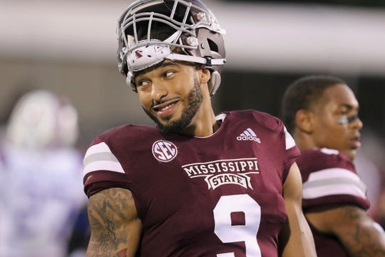 Mississippi State defensive end Montez Sweat (9) smiles while resting during warm-up drills.