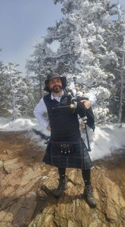 Dustin Hatfield plays the bagpipes every year at Mt. LeConte. The annual hike is an Easter tradition with his family.
