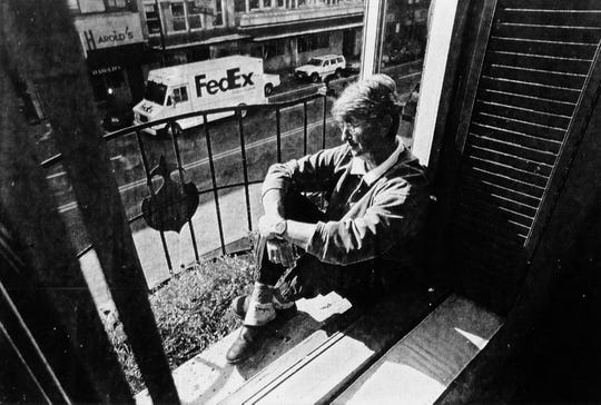 """The caption of this Knoxville News Sentinel photo dated November 1998 reads: """"A perk of living downtown for Patti Smith is watching people go by from her second floor window. Smith says her neighbors often come by and wave, then come up for a visit."""""""