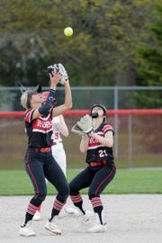 Lafayette Jeff second baseman Chayton Krueger (21) watches as Lafayette Jeff short stop Emilee Cox (4) makes the catch in the infield during the fourth inning of a high school softball game, Monday, April 22, 2019, at Cumberland Park in West Lafayette. Lafayette Jeff won, 8-3.(Nikos Frazier   The Journal & Courier)