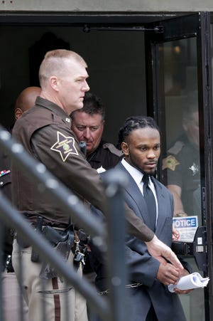 Deshay Hackner is escorted out of the Tippecanoe County Courthouse by sheriff's deputies, Tuesday, April 23, 2019, in Lafayette. Hackner is accused of killing Dewone Broomfield and Mary Woodruff in Vanderburgh County.