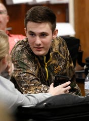Bryson L'Huillier, right, talks to a classmate Tuesday morning, April 23, 2019, before class at Amanda-Clearcreek High School in Amanda.