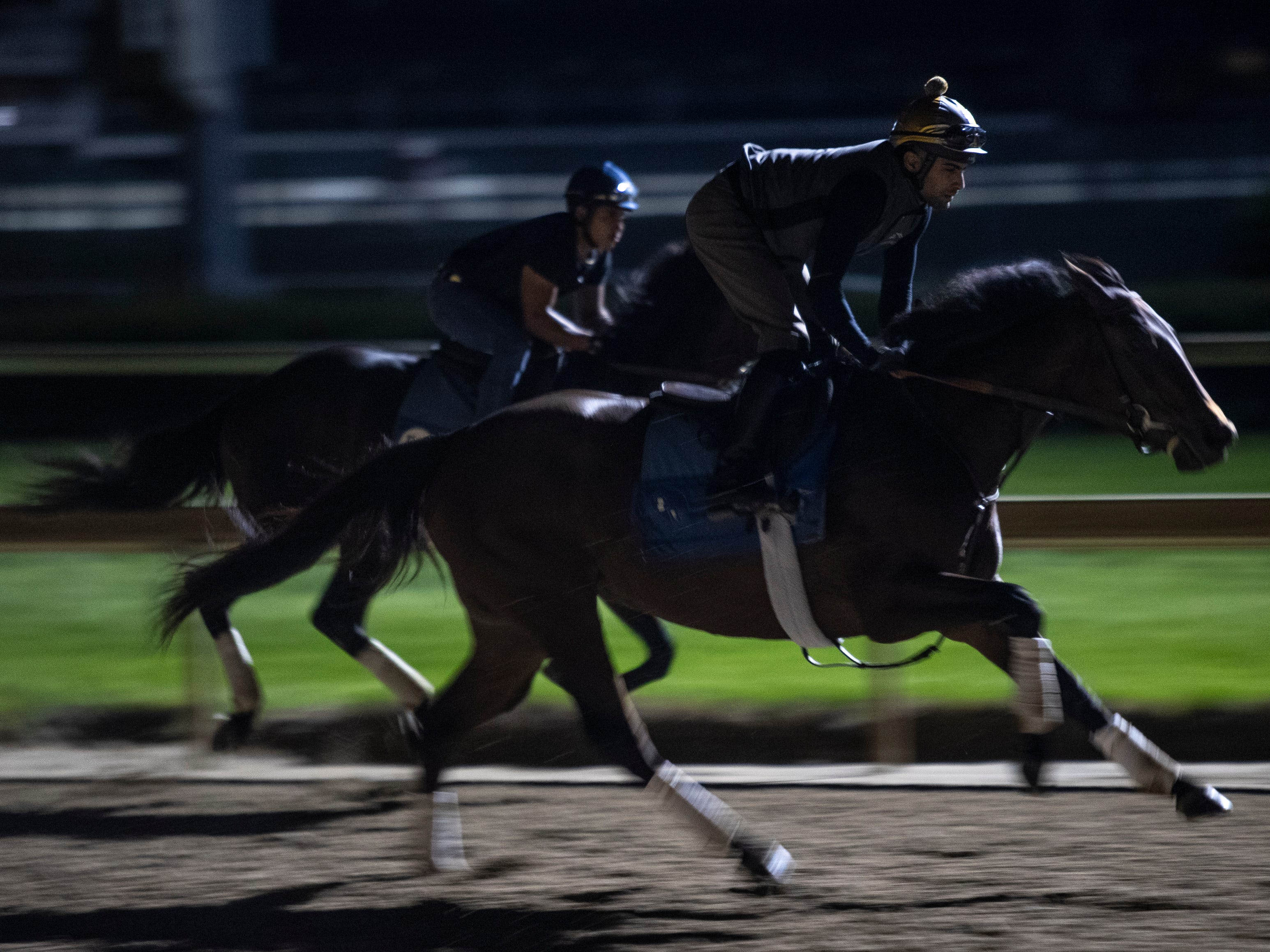 Horses train before sunrise at Churchill Downs. April 23, 2019.