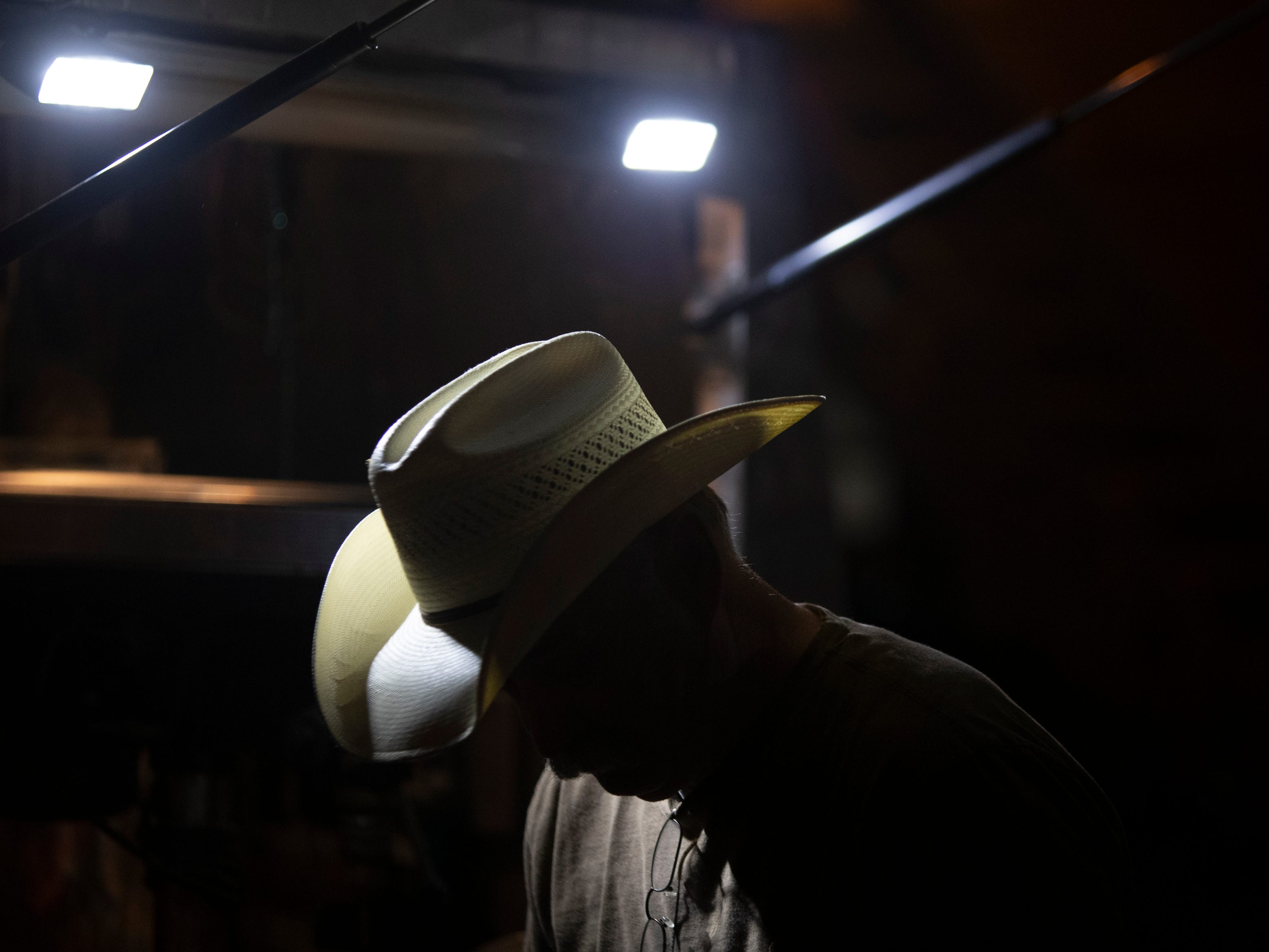The light from his work truck reflects off the cowboy hat of blacksmith Steve Norman. Norman has been a blacksmith since 1970. April 23, 2019.