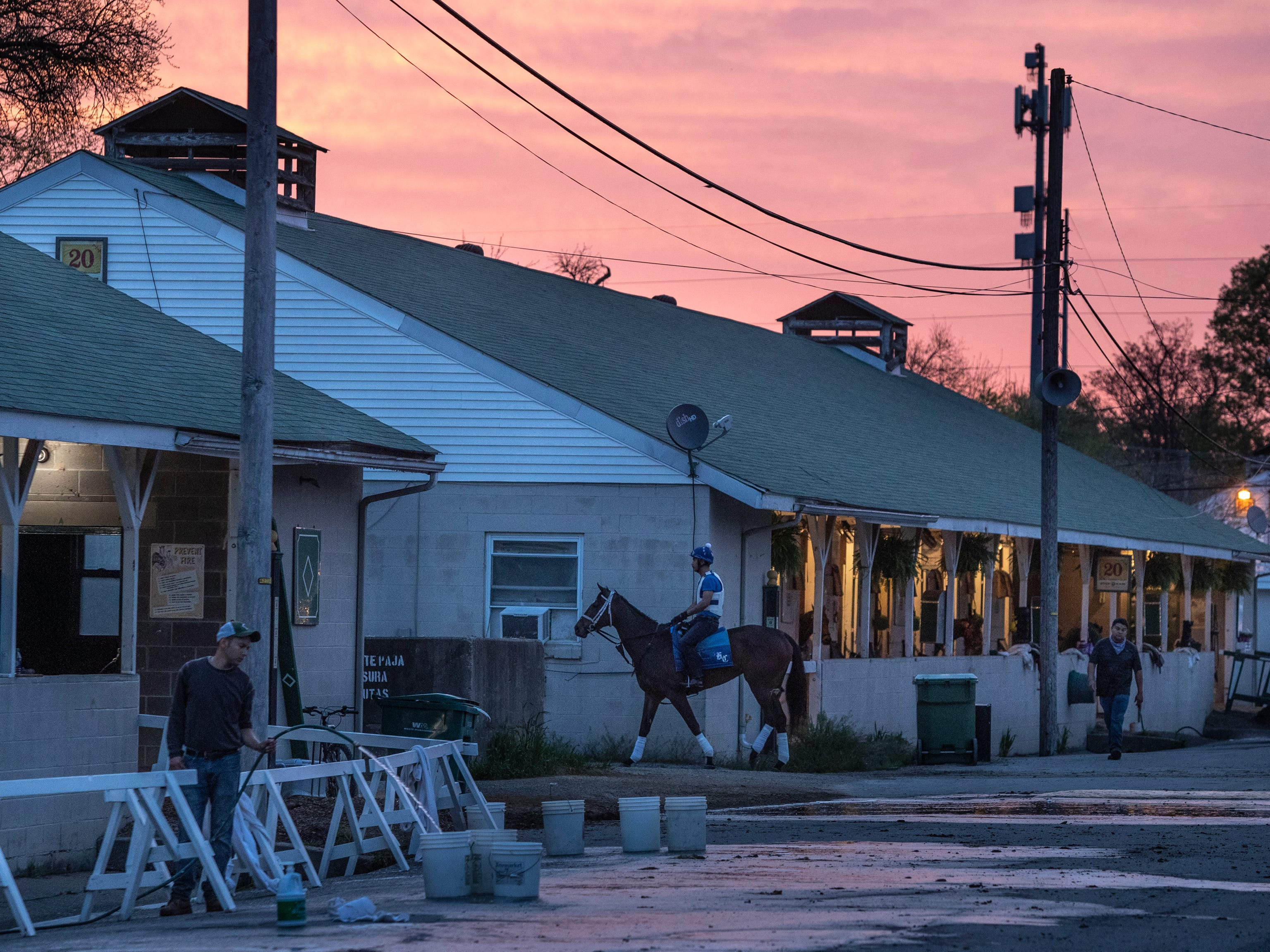 The morning sky glows over the backside of Churchill Downs. April 23, 2019.