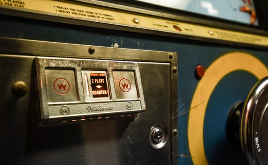 """A detail shot of Ryan Claytor's """"Penny Pitch,"""" It's an electromechanical arcade game from the 1970s. Claytor, an assistant professor in the Department of Art, Art History and Design at Michigan State University, has a collection of 15 pinball machines in his basement."""