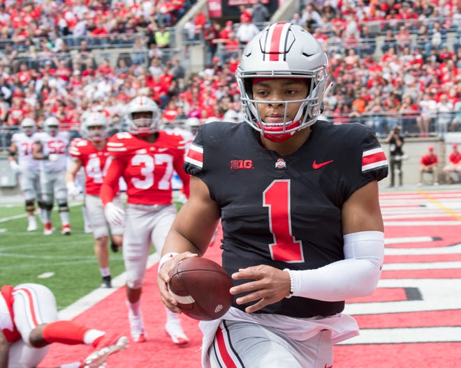 Ohio State quarterback Justin Fields scores on a 5-yard run in the spring game.