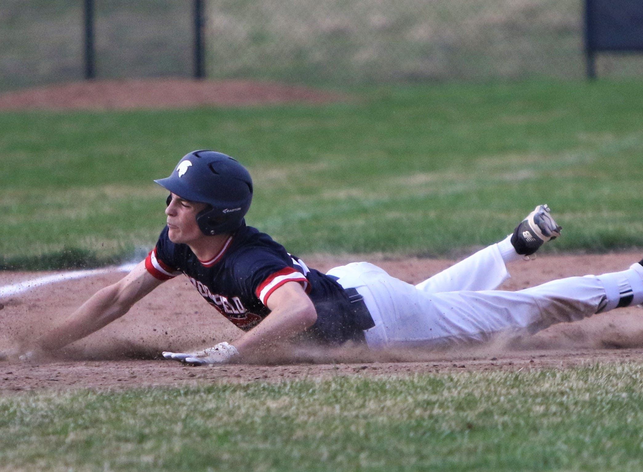 Brookfield East senior Ethan Toone slides into third base with a triple against Brookfield Academy on April 22, 2019.