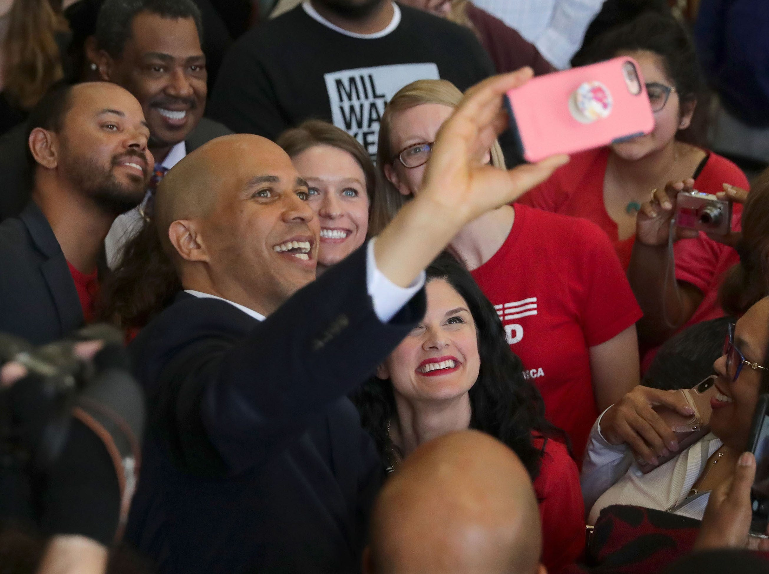 U.S. Sen. Cory Booker takes a selfie with supporters. Booker made a campaign stop at Coffee Makes You Black on North Teutonia Avenue in Milwaukee on Tuesday. Booker, of New Jersey, one of several Democratic presidential contenders to campaign in Wisconsin, held a discussion on gun violence prevention.
