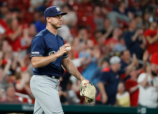 Brewers relief pitcher Jacob Barnes walks back to the mound after giving up an RBI-single to the Cardinals' Yadier Molina during a brutal seventh inning Monday night.
