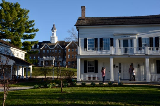 Hawks Inn, built in 1845 by Nelson P. Hawks in the Greek Revival style as a stagecoach stop, was the center of social and political life in the frontier village of Delafield. It is on the National Register of Historic Places and is open for public tours. The Delafield Hotel stands to the left at the rear of the photo.