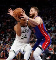 Bucks forward Giannis Antetokounmpo  is defended by Detroit Pistons forward Blake Griffin during the first half.