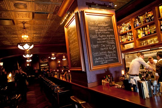 The bar at the Rumpus Room, shown in 2011, has a chalkboard listing the day's specials.