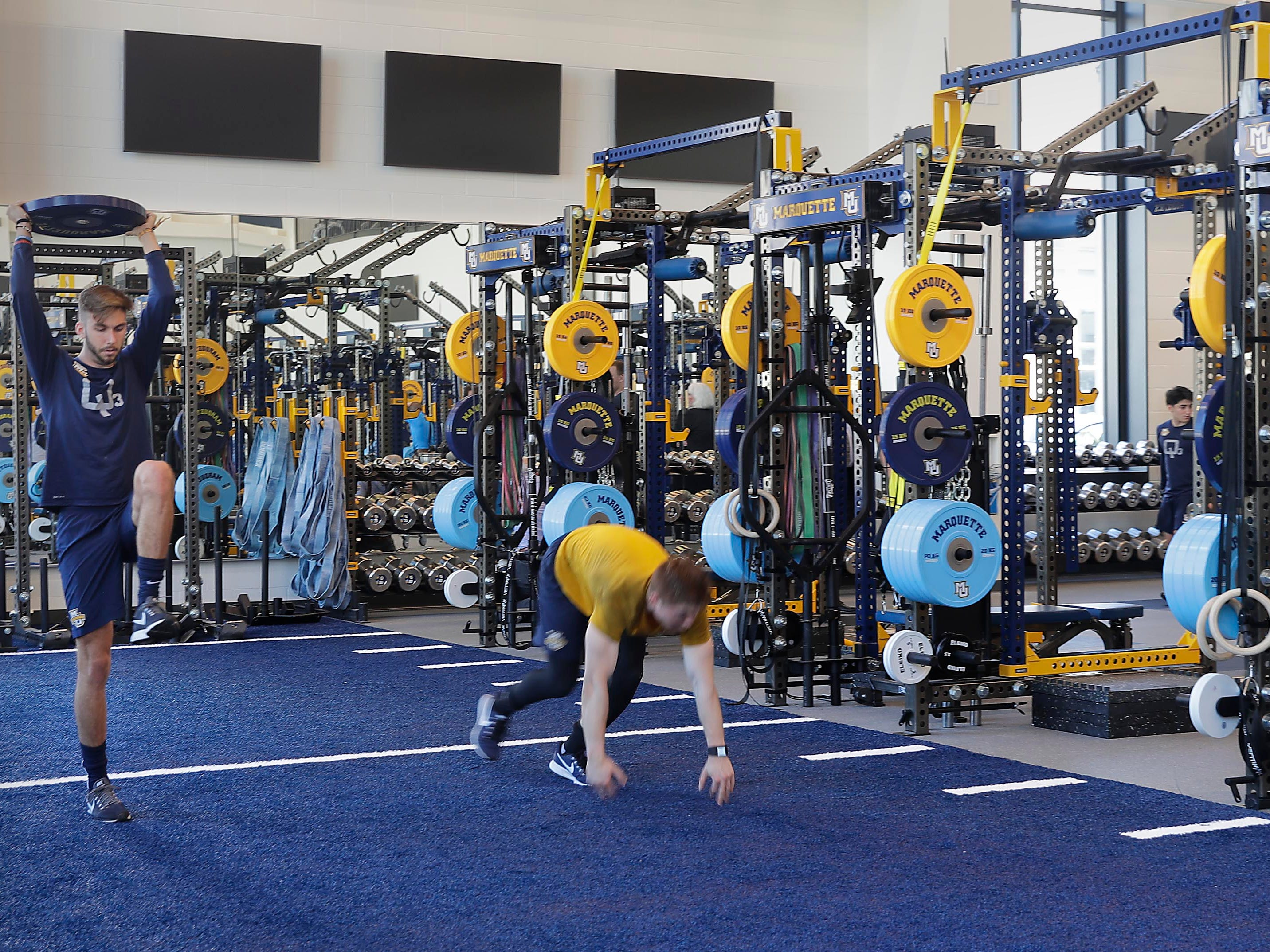 The $24 million Athletic and Human Performance Research Center at Marquette University features a large space for strength and conditioning. The center is located across from the Al McGuire Center.