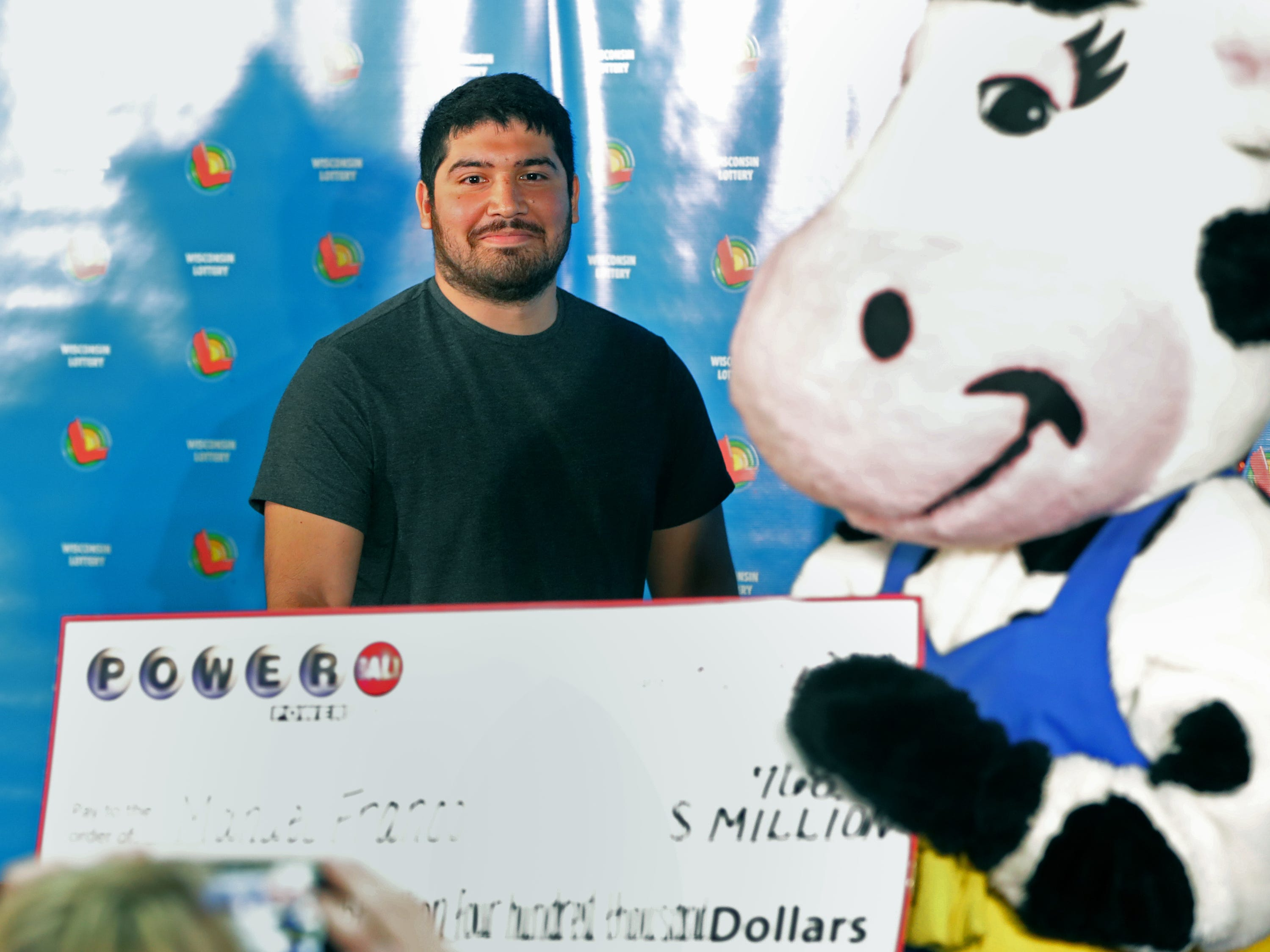 Manuel Franco, who purchased the $768.4 million Powerball ticket sold last month in New Berlin, appears at a news conference Tuesday, April 23, 2019 at the Wisconsin Lottery's offices in Madison, Wis. It was the largest jackpot in the Wisconsin lottery's history and the third-largest lottery prize in U.S. history. The lump sum payout is $477 million.