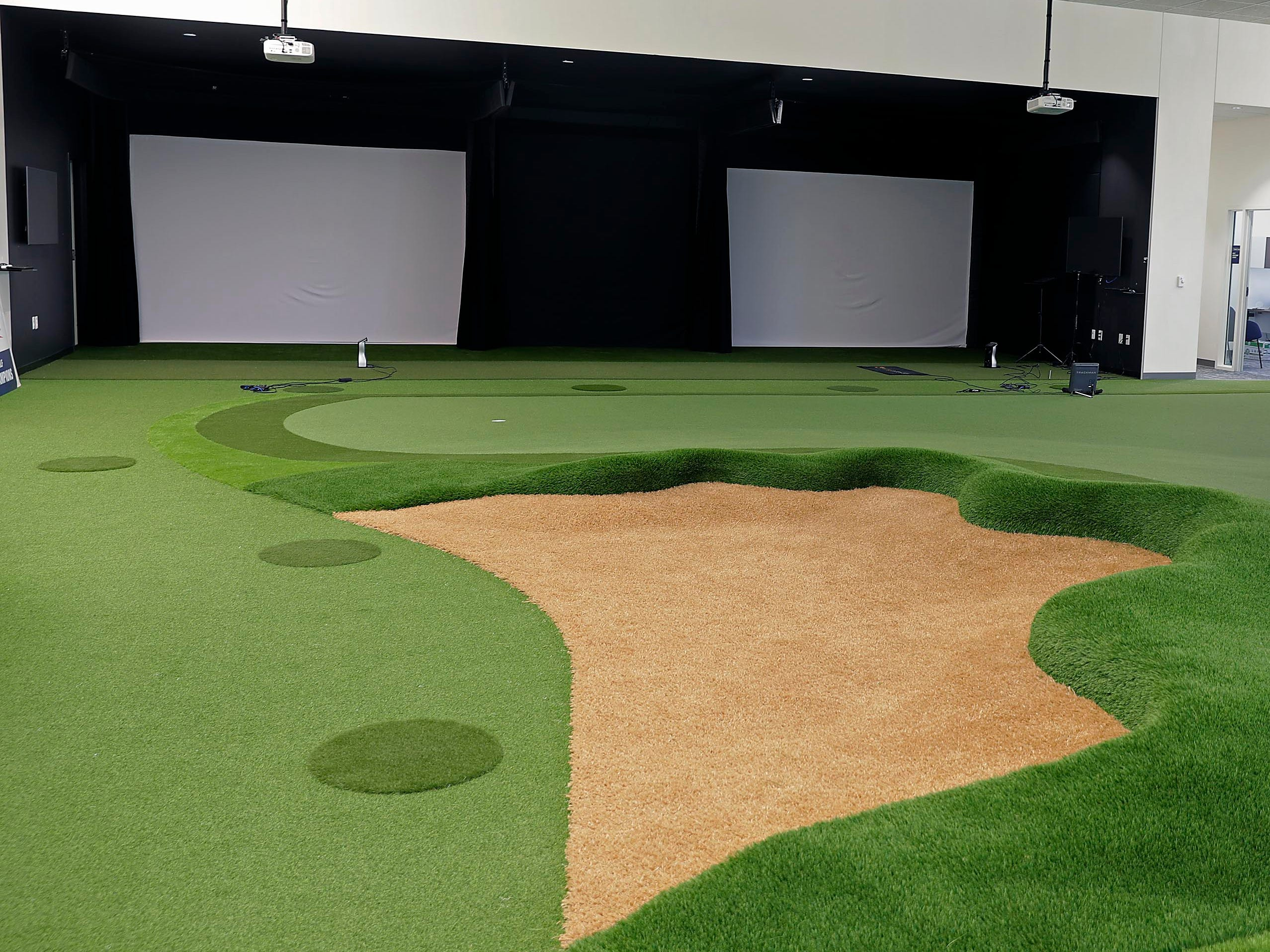 The golf team has a year-round putting green and swing analysis equipment to help players improve.